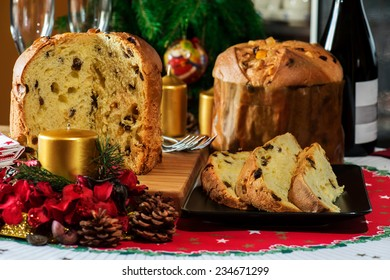 "italian typical christmas cake called ""panettone"" on table with christmas tools"