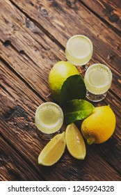Italian typical digestive limoncello with fresh lemons, selective focus and toned image
