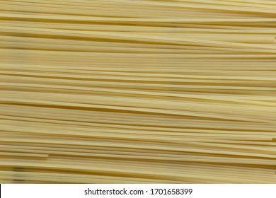 Italian uncooked long spaghetti as background
