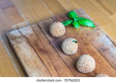 Italian vegan meatballs with eggplants on a rustic wooden table. closeup