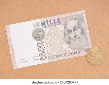 Italian vintage and new currency. Lira note and 50 Euro cents coin. The exchange rate when the euro was first adopted was approximatey 1000 lire to 50cents.