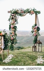 Italian wedding decoration. Green eucalyptus, oranges and pink flowers decorate wedding altar