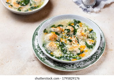 Italian wedding soup with meatballs, spinach and ptitim paste