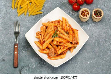 Italian Wholemeal Pasta Penne with Tuna and Basil. Fresh pasta with tuna and tomato sauce