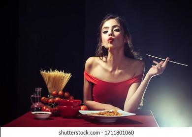 Italian woman in eats spaghetti pasta. Woman cooked spaghetti. Italian food and menu concept. Woman sucks pasta and spaghetti