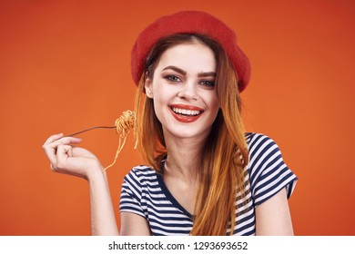 italian woman in red beret smiling holding fork with spaghetti pasta