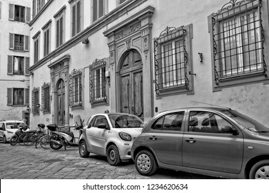 Italian yard with buildings, cars and bicycles, cobblestone patio. Car2go. Urban landscape. Classic Photo. Black and White Photography. Italy, Florence – April 17, 2018