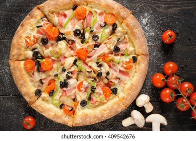 itallian pizza with tomatoes and mushrooms ingredients on a darkness wooden background