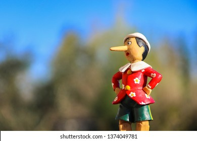 Italy - 04-11-19: little statue of Pinocchio   (character from an italian fable)