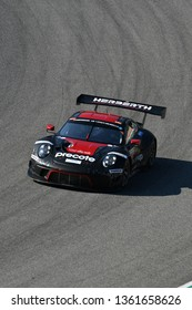 Italy - 29 March, 2019: Porsche 911 GT3 R of Herberth Motorsport Germany Team driven by Daniel Allemann/Ralf Bohn/Robert Renauer/Alfred Renauer in action during 12h Hankook Race at Mugello Circuit.