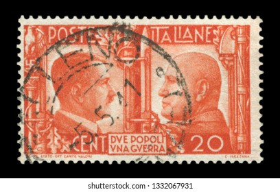ITALY - 5 May 1941:  Italian historical stamp: German-Italian brotherhood in arms, Portraits of Hitler and Mussolini with symbols of the Nazi and fascist regime of the two countries, Italy, postmark,