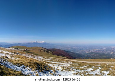 Italy, Abruzzo Region. The Blockhaus of Maiella Mountains at daylight, landscape, blue sky, snow, no clouds. The snowy Gran sasso d'Italia and the adriatic sea at the foreground
