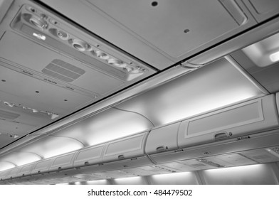Italy, airplane cabin with the no smoking signs on