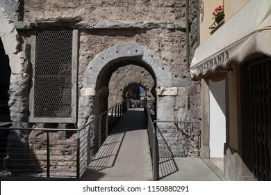 ITALY, AOSTA - JULY 8: View to the Porta Pretoria what  is the eastern entrance of the Roman city of Augusta Praetoria Salassorum (Aosta today)  on 8 July 2018 Aosta, Italy.