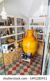 Italy, Apulia, Province of Brindisi, Cisternino. May 30, 2019. Interior of a shop selling olive oil and wine.