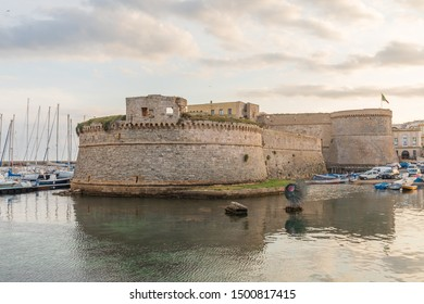 Italy, Apulia, Province of Lecce, Gallipoli. June 03, 2019. View of the walled old city from the harbor with Castello Angioino Aragonese Angevine (Angevine-Aragonese Castle).