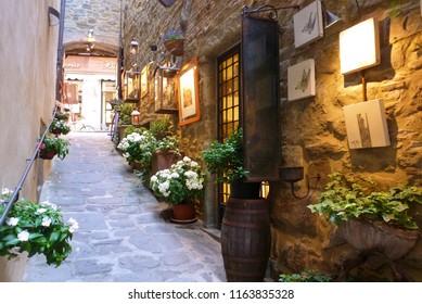 Italy, Arezzo, Cortona, July 2016 characteristic narrow alley in the village of Cortona of Etruscan origins in the province of Arezzo in Tuscany