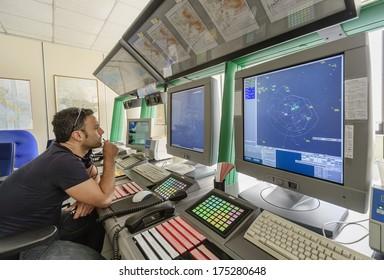 Italy, Bari, International airport, flight control tower, flight controller working