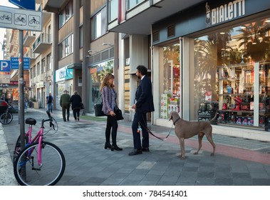 ITALY, BARLETTA - OCTOBER 3: Barletta is located on the Adriatic sea coast. Street with people and dog on morning time, Barletta, 3 October 2017, Italy.