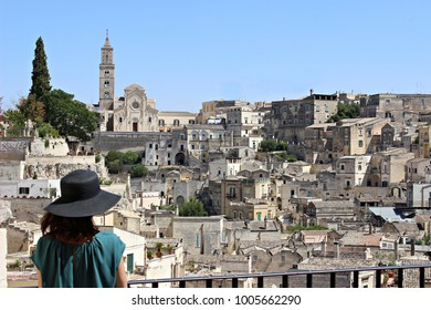 Italy, Basilicata: Woman with hat admiring Matera.