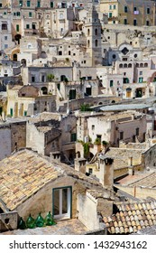 Italy, Basilicata/Matera - september  01  2013: Glimpse of a terrace and roof top of the ancient stone city of Matera,in the southern Italy, Unesco heritage city and  european Capitals of Culture 2019