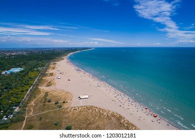 Italy, the beach of the Adriatic sea. Rest on the sea near Venice. Aerial drone photography.