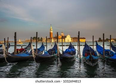 Italy beauty, afternoon with anchored gondolas and San Giorgio Maggiore island , Venice, Venezia