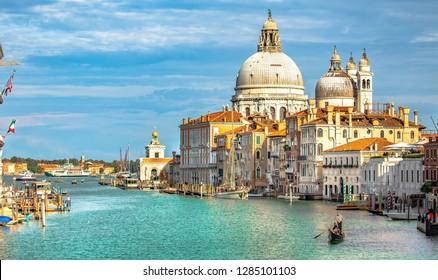 Italy beauty, cathedral Santa Maria della Salute and gondola on Grand canal in Venice, Venezia