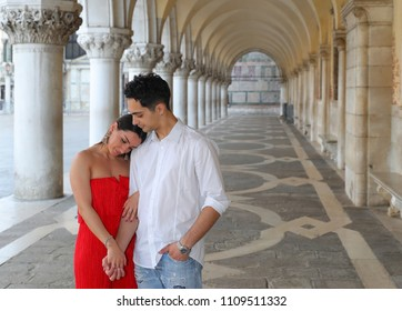 Italy beauty, pretty girl and boy in colonnade on San Marco Square in Venice, Venezia