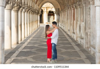 Italy beauty, pretty girl and boy in colonnade on San Marco Square, Venice, Venezia