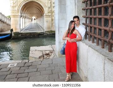 Italy beauty, pretty girl and boy close to Sospiri bridge, Venezia, Venice