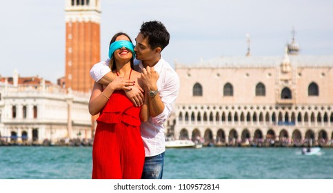 Italy beauty, pretty girl and boy with view to bell tower of San Marco square, Venezia , Venice