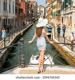 Italy beauty, pretty girl on one of attractive canal bridges in Venice , Venezia