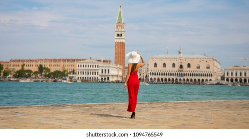 Italy beauty, pretty girl with view to San Marco square, Venice, Venezia