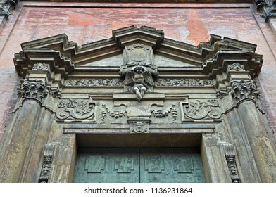 Italy, Bologna Santissimo Salvatore Baroque style church front door top decorations.