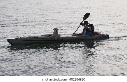 Italy, Bracciano lake (Rome); 6 April 2016, a man with his dog canoeing on the lake - EDITORIAL