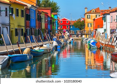 ITALY, BURANO - SEPTEMBER 26, 2017: Multicolored  houses and  boats on Burano island