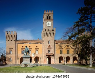 Italy, Busseto. The Giuseppe Verdi theatre, opera house. The Palazzo del Corriere (15th century) and the fortress (1250). In the foreground the monument to Giuseppe Verdi.