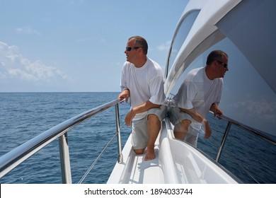 Italy, Calabria, Mediterranean Sea, Maratea; 4 August 2006, man on a PERSHING 62 luxury yacht - EDITORIAL
