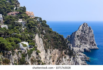 Italy. Capri Island. Faraglioni rock formation and town Capri seen from Gardens of Augustus