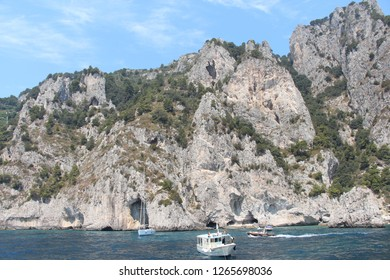 Italy, Capri - July 19, 2017: View on island of Capri from water. Capri is a tourist destination for both Italians and foreigners. In the 1950s Capri became a popular resort.