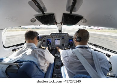 Italy, Ciampino airport (Rome); 26 July 2010, pilots in an airplane's cockpit ready for takeoff - EDITORIAL