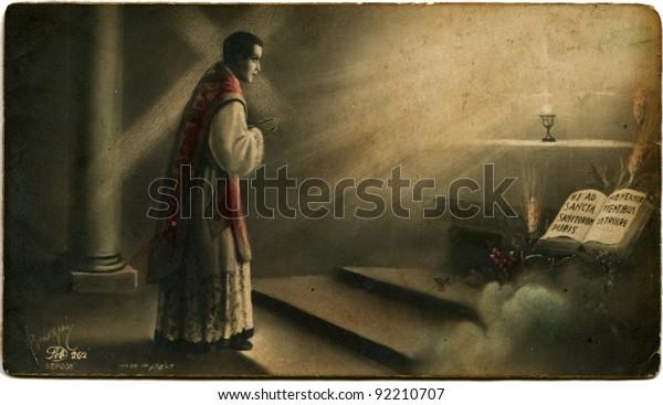 ITALY - CIRCA 1934: Reproduction of antique postcard shows Jesus blesses the Catholic priest, circa 1934