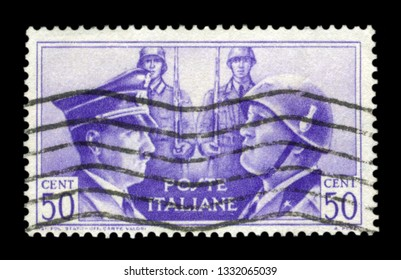 ITALY - CIRCA 1941:  Italian historical stamp: German-Italian brotherhood in arms, Portraits of Hitler and Mussolini with two soldiers,Italy, postmark, ww2