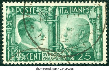 "ITALY - CIRCA 1941: A stamp printed by the fascist Italy Post is a portrait of Adolf Hitler and Benito Mussolini. It is entitled ""Due popoli una guerra"" (Two nations one war), circa 1941"