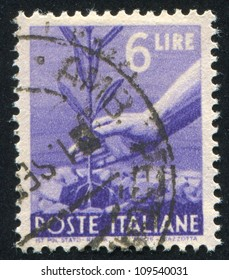 ITALY - CIRCA 1945: stamp printed by Italy, shows Planting Tree, circa 1945