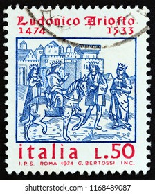 ITALY - CIRCA 1974: A stamp printed in Italy issued for the 500th birth anniversary of poet Ludovico Ariosto shows Cover Engraving of Ariosto's Orlando Furioso, circa 1974.