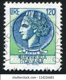 ITALY - CIRCA 1977: stamp printed by Italy, shows head of a woman, who symbolize Italy after Syracusean Coin, circa 1977