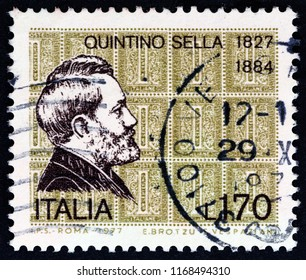 ITALY - CIRCA 1977: A stamp printed in Italy from the issued for the 150th birth anniversary of statesman Quintino Sella shows Quintino Sella and 1863 stamps, circa 1977.