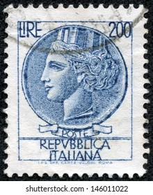 ITALY - CIRCA 1977: stamp printed in Italy shows head of a woman, who symbolize Italy after Syracusean Coin, circa 1977